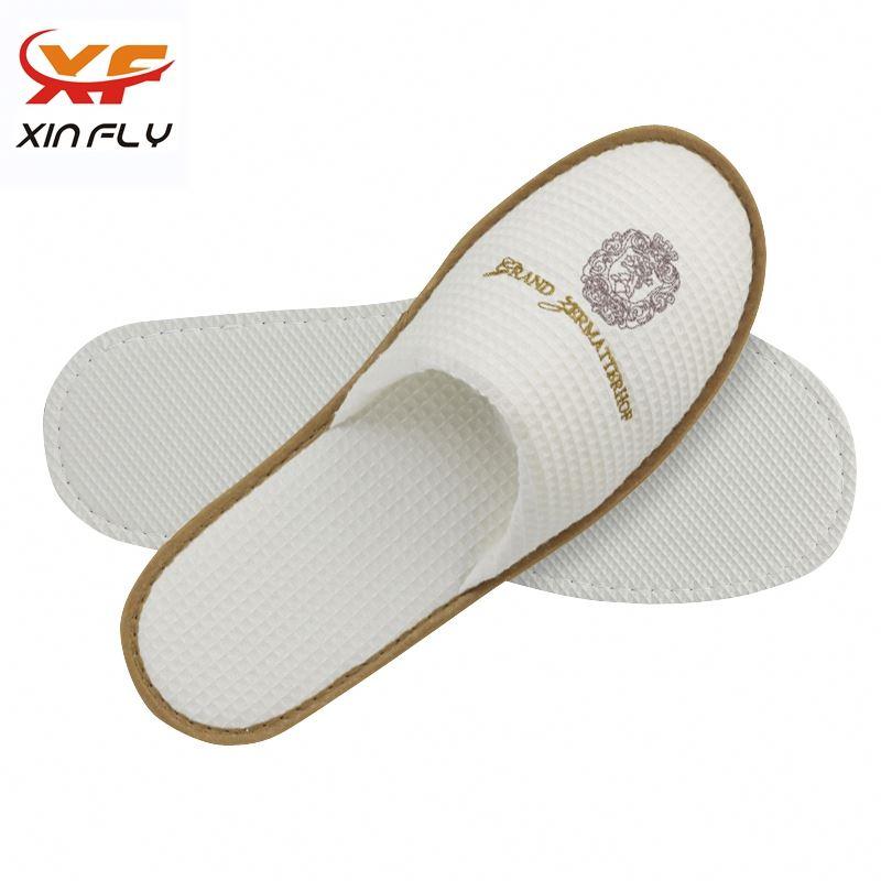Comfortable EVA sole soft hotel slipper with logo